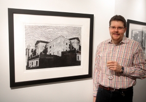 "Artist Brandon Hodgkin with his work ""After the Storm""."