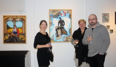 "Amy Cannon, Jill Carey and Alex Zvagin in front of Alex's work ""The Prophecy Reader"""