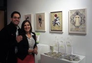 Or Gadish and Ana Linares in front of Ana's Floriography Tarot series
