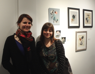 Dina Shaposhnikova and Lindsey Boss in front of Lindsey's collage series