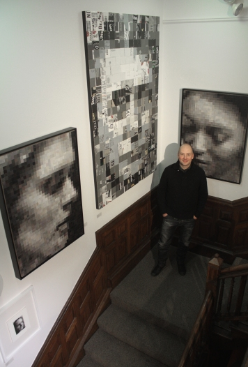 David Strauzz in front of his work