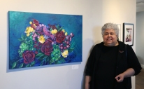 "Professor Maritza Farrell and her painting ""Mimi's Roses"""