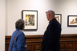Jean Stringham and Professor Stephen Fischel looking at the artwork by Vladimir Zimakov