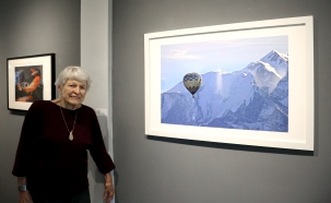 "Village resident Ellie Ramsey and her photograph ""Floating - Mt. Blanc"""