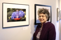 "Village resident Jean Stringham and her photograph ""Hummingbirds & Hydrangea"""