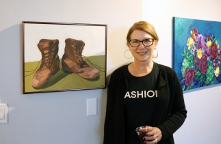 "Professor Gail Jauregui and her painting ""Teddy's Shoes"""