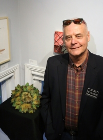 "Professor Stephen Fischer in fron of his sculpture ""Autumn Green Man"""